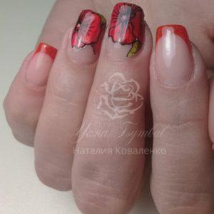 Коррекция ногтей гелем выкладной френч красного цвета с дизайном